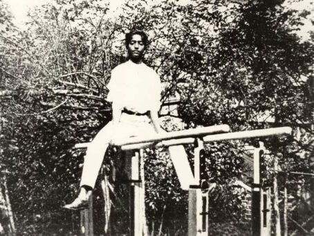 K Sitting on Parallel Bars